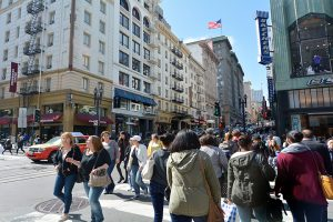 San Francisco, California, USA - May 17, 2015: Padestrians walk down the steet in San Francisco. It has a density of about 18,187 people per square mile (7,022 people per km2) making it 2nd-most densely populated city in US after New York City.
